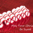 Old Fashioned Merry Christmas Ribbon Candy on Red Background Greeting — Stock Photo #30464723