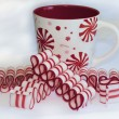 Holiday Ribbon Candy and Festive Christmas Mug — Stock Photo #30468035