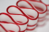 Old Fashioned Red and White Christmas Ribbon Candy Macro — Stock Photo