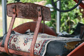 Vintage Tractor Seat and Persian Carpet — ストック写真