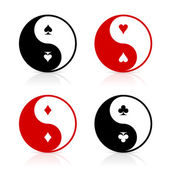 Yin-Yang symbols with card suits — Stock Vector