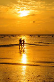 Silhouette at beach and sunset — Stock Photo