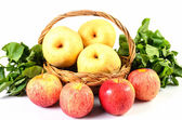 Apple and Asiatic in basket on white background — Stockfoto