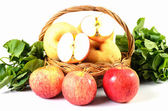 Apple and Asiatic in basket on white background — Stock Photo