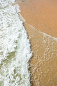 Wave of the sea on the sandy beach — Stock Photo