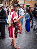 Rome 29th May 2013 : Roman Soldier using his cell phone in the street — Stock Photo