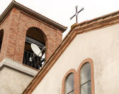 Satellite dish and cross on church — Stock Photo