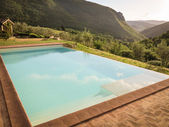 Infinity pool in the mountains — Stock Photo