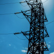 Power lines against the sun — Stock Photo