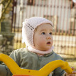 Baby girl riding her bike — Stock Photo