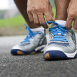 Stock Photo: Tying sports shoe
