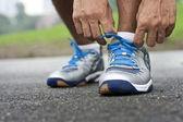 Tying sports shoe — Stock Photo