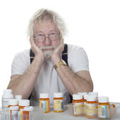 Senior with lots of prescriptions — Stock Photo