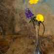 Purple and yellow wildflowers in an antique silver vase on a sla — Stock Photo #31535073
