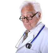 Kindly mature doctor wearing a white lab coat and blue stethosco — Stock Photo