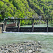 Stock Photo: Hydroelectric plant - Paddle outflow
