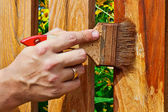 Painting the wooden fence — Стоковое фото
