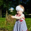 Little girl with a straw — Stock Photo