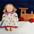 Wooden doll and train — Stock Photo
