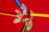 Sharpened colored pencils and wood shavings — Stock Photo