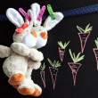 Stock Photo: Chalkboard with carrots and toy rabbits