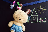 Chalkboard with drawing and soft toy — Stock Photo