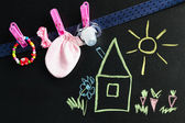 Blackboard with drawing and Set for newborn baby girl — Stock Photo