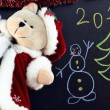 Stock Photo: Cristmas bear on chalkboard