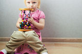 Small girl sits on a potty — Stock Photo