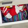 Stock Photo: Open dresser drawer with socks