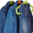 Denim child clothes hang in a closet — Stock Photo