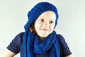Funny beautiful Girl in knitted beret shrugs — Stock Photo