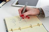 Businesswoman  doing mathematical calculations — ストック写真