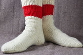Legs  in a red and white socks — Stock Photo