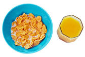 Bowl of corn flakes  with orange juice , top view — Stock Photo