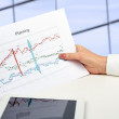 Businesswoman holding graph in her hand . The digital tablet is — Stock Photo #47425149