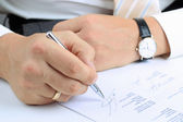 Businessman  sitting at office desk and  signing a contract — Foto de Stock