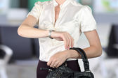 Well- dressed businesswoman checking time on her watch — Stock Photo