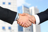 Close-up image of a firm handshake  between two colleagues outsi — Stock Photo