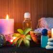 Three candles , towels , salt, oil and stones — Stock Photo #29980935