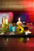 Daisy, oil, stones, salt and candle — Stock Photo