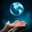 Blue world in hands — Stock Photo