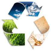 Recycling symbol: cloudy sky, water, grass — Stock Photo