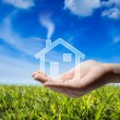 Buy home - Icon house in the hand - grass and sky — Stock Photo #30579779