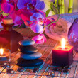 Candles, oil, potpourri, stones, glass dots, orchids and bamboo — Stock Photo