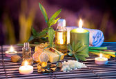 Lemon soap , oil, towel, salt, bamboo, and candles in garden — Stock Photo