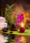 Massage - bamboo - orchid, towels, candles , stones-vertical — Stock Photo