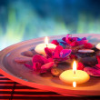 Dish spa with floating candles, orchid, in garden — Stock Photo