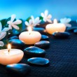 Candles and black stones on black mat  — Stock Photo