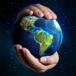 Earth in the hands - Universe background - USA — Stock Photo #32456661